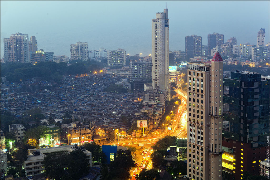 The contrast between the rich &amp; poor, slums and high-rises in Mumbai